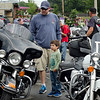 Jackson Hendershaw, 4, and dad Jason check out the bikes during the Good Times Motorcycle Run in memory of hit-and-run victim Frankie Fortuna on Saturday morning. SENTINEL & ENTERPRISE / Ashley Green