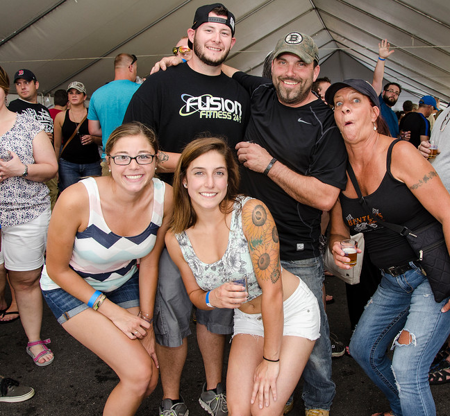 Sarah Roberge, Shawna Schofield, Craig Roberts, Steve Gontheir and Diane Schofield hang out at the Johnny Appleseed Craft Beer Festival in downtown Leominster on Saturday afternoon. SENTINEL & ENTERPRISE / Ashley Green