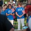 Mary Brooks (left) and Donna Fiduccia look on as Leominster Mayor Dean Mazzarella and Interim Police Chief Michael Goldman address the crowd during a Peace Vigil in Monument Sq. SENTINEL&ENTERRPRISE/ Jim Marabello