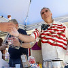 Mayor Dean Mazzarella handed out chocolate covered marshmellows at the Leominster Summer Stroll in downtown on Saturday afternoon. SENTINEL & ENTERPRISE/JOHN LOVE
