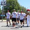 Players for the Wachusett Dirt Dawgs participated in the parade to start off the Leominster Summer Stroll in Downtown on Saturday afternoon. SENTINEL & ENTERPRISE/JOHN LOVE