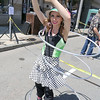 Little L., aka Laura Hanley, of Lunenburg entertained the crowds with her hula hooping skills at the Leominster Summer Stroll in downtown on Saturday afternoon. SENTINEL & ENTERPRISE/JOHN LOVE