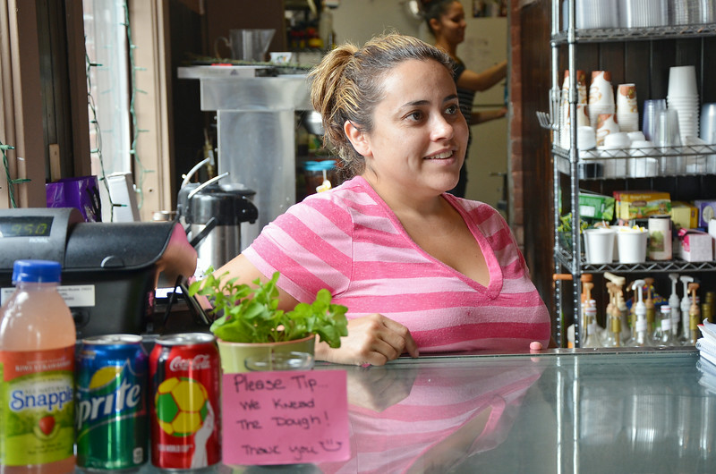 The City of Leominster was ranked #1 on Movoto.com's list of most boring towns in Massachusetts. Pictured is Gloria Castano, owner of Sweet Creations by Gloria located in downtown Leominster. SENTINEL & ENTERPRISE / Ashley Green