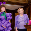 Wendy Wiiks presents event founder Sandy Long with flowers during the annual Light the Town Purple event at Leominster City Hall in support of the Greater Gardner Relay for Life to be held in June. SENTINEL & ENTERPRISE / Ashley Green