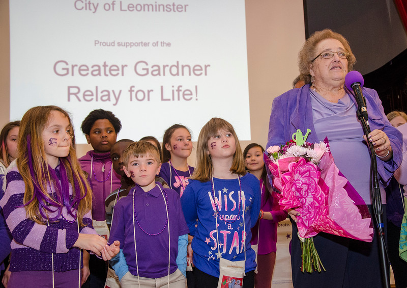 Sandy Long, founder of Light the Town Purple, speaks during the event at Leominster City Hall on Thursday evening. The annual event is held to show support for the Greater Gardner Relay for Life to be held in June. SENTINEL & ENTERPRISE / Ashley Green
