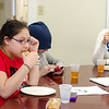 Danisha Douglas enjoys a snack during the new afterschool program at the Leominster Spanish American Center on Wednesday afternoon. SENTINEL & ENTERPRISE / Ashley Green
