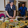 Leon Ou, from Yamato Japan, serves up some sushi during the Taste of Leominster on Wednesday evening at City Hall. SENTINEL & ENTERPRISE / Ashley Green