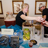 Tracy Sladden serves up a Rum Swizzle drink from 435 Bar and Grille during the Taste of Leominster on Wednesday evening at City Hall. SENTINEL & ENTERPRISE / Ashley Green