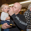 Gannon Giles samples some treats with the help of dad Jeff during the Taste of Leominster on Wednesday evening at City Hall. SENTINEL & ENTERPRISE / Ashley Green