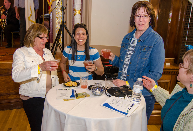 Christine Brockelman, Melissa Tasca and Ann-Marie Giampietro share a laugh during the Taste of Leominster on Wednesday evening at City Hall. SENTINEL & ENTERPRISE / Ashley Green