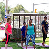 The Yoga on the Common group participates in a class led by Yvonne Stevens on Saturday morning. SENTINEL & ENTERPRISE / Ashley Green