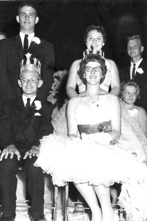 Royalty is center stage with crowns resting on the heads of the boy and girl seated in the photo. If you can identify any of the people in the photo, or know when or where the photo was taken, post under the photograph on the Effingham Daily News Facebook page.