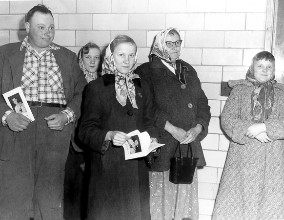 A group, possibly of family members, gathers in a hallway waiting for an awards ceremony or program. If you can identify the individuals, or have information on when or where the photo was taken, post below the photo on the Effingham Daily News' Facebook page.<br /> <br /> Doug Feldhake says: From left, Oren Bohnhoff, Karen Bohnhoff, Sharon Bohnhoff, Zelda Bohnhoff and Nancy Bohnhoff. Not sure of the location of the picture. I would guess taken around 1954-1960. Maybe T-Town High School Gym Hallway?