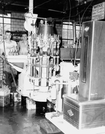 Two employees are shown at a bottling facility, possibly the Dr. Pepper bottling plant located in Effingham from the 1930s until the 1960s. If you recognize the plant or employees, post under the photo on the Effingham Daily News Facebook page.