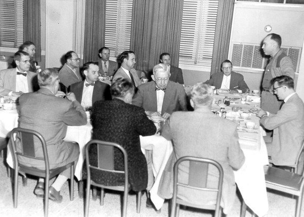 Suits, bowties and white tablecloths were all on display at this meeting. Do you recognize the men? Post the information under the photo on the Effingham Daily News Facebook page.