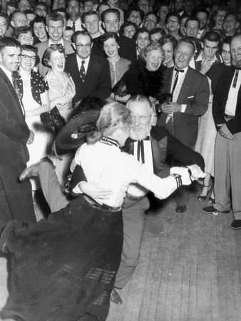 A couple kicks up their heels and entertains the crowd at an event in years past. Do you know any of the people or what event is depicted? Post the information under the photo on the Effingham Daily News Facebook page.