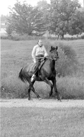 A young girl and her horse are enjoying a ride in the country. Do you recognize her? Post the information under the photo on the Effingham Daily News Facebook page.