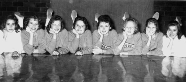 Eight young girls (maybe cheerleaders?) rest on a gymnasium floor. GGS are the letters on their sweaters. If you recognize these young athletes, enter the information online under the photo on the Effingham Daily News Facebook page.