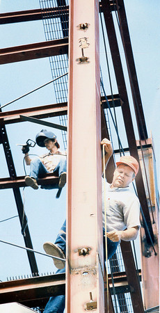 Two men are busy working on a structure. Do you recognize them? Post the information under the photo on the Effingham Daily News Facebook page.