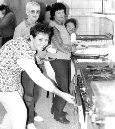 December 1987 — Effingham Zonta Club President Carlissa Puckett, front, along with members, in back left to right, Kate Bourland, Jude Ealy and Dorothy Lange work on treats to be sold during the Zonta Club's annual cookie sale.