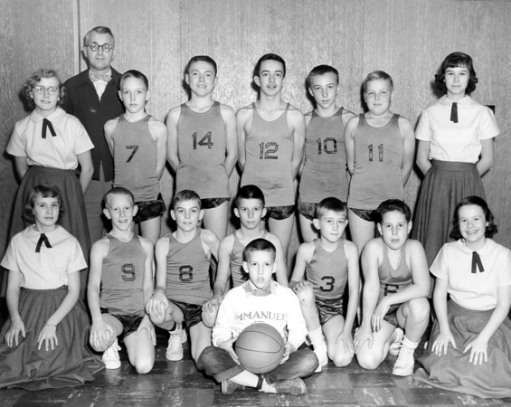 A proud group of students make up this basketball. Does anyone know what year the photo was taken, or can you identify the students or coach?