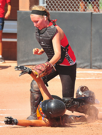 Southern Plains catcher Savanna Gyurman tags out Lamar's Lexi Coen at home plate  during the 2014 Babe Ruth 16U Midwest Plains Regional played July 17-20 at Citizen's Field in Lamar.