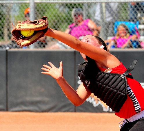 Southern Plains catcher Savanna Guyerman makes a catch on a foul ball  during action against Lamar in the second game of the championship bracket in the 2014 Babe Ruth 16U Midwest Plains Regional.  Southern Plains upset  the defending regional champion Lamar, 7-6, to earn a berth to the 16U World Series to be played July 30 thru August 5 in Pittsfield, Mass.