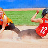 Savanna Gyurman of Southern Plains steals second base as Lamar shortstop Alex Choat looks on during the 2014 Babe Ruth 16U Midwest Plains Regional played July 17-20 at Citizen's Field in Lamar.