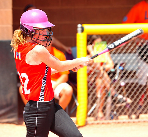 Southern Plains first baseman Macy Kennedy of Holly swings for a base hit during action against Lamar on Saturday in the 2014 16U Midwest Plains Regional softball tournament that was held July 17-20 at Citizen's Field in Lamar. Southern Plains defeated Lamar, 7-6, in the final game of regional on Sunday to win the championship. With the win, Southern Plains earned a trip to the 16U World Series to be played July 30 thru August 5 in Pittsfield, Mass.