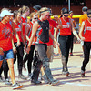 The Southern Plains teams heads to the dugout after they rallied to beat Lamar, 11-7, in the champoionship semifinals on Saturday in the 2014 Babe Ruth 16U Midwest Plains Regional played July 17-20 at Citizen's Field in Lamar.