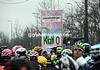 The peloton comes to a momentary stop at 'Kilometro 0'...