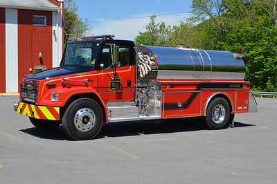"New Creek, WV placed their ""new"" Tanker 38 in service in 2016.  The 1994 Freightliner 80/4-Guys 500/1500 was originally delivered to Blue Ridge Mountain VFD in Jefferson County, West Virginia.  It was painted red and white.  The tanker was then sold to Bakerton, West Virginia (also in Jefferson County) in 2014.  When New Creek received it, they had some local work done on it including the black roof and chevron striping.  It carries 4-Guys job number F-1645."