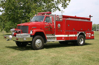 Former Tanker 12 from Berkeley Springs, WV is this 1987 GMC Brigadier/American Eagle front mount 1250/1500.  Serial number 1088.  Sold to a private owner in 2017.