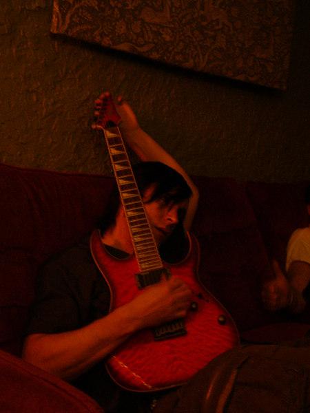 Tim Boykin tuning his guitar.  At Bottletree.