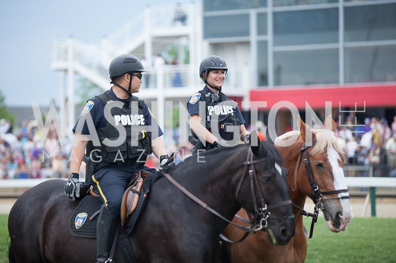 Police men and women patroling on Horses