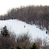 A snowboarder and skiers make their way down a trail at Wachusett Mountain Ski Area in Princeton, Wednesday afternoon.<br /> SENTINEL & ENTERPRISE / BRETT CRAWFORD