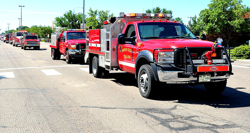 A long line of fire and emergency vehicles make their way down the parade route during the 2014 Sand & Sage Parade on Saturday, Aug. 3