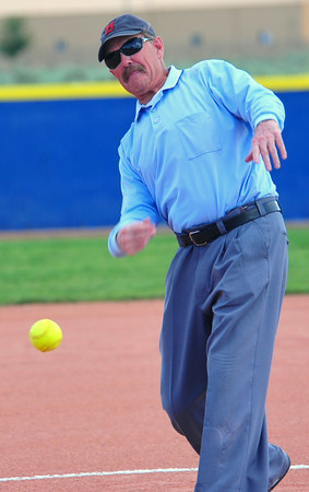 Dick Peecher, long-time umpire and a former successful coach in football and girls basketball,  throws out the first pitch during the Opening Ceremonies in the Colorado Babe Ruth 14 & Under and 16 & Under State Tournaments that were held at the Lamar Softball Complex over the weekend.