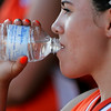 Lamar's Mireya Aguirre quenches her thirst from the heat during the Colorado Babe Ruth 16 & Under State Tournament that was held over the weekend in Lamar. The players had to overcome high temperatures during the course of play in the tournament.