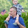 Keegan Caplis, 2, of Templeton, gets  a lift from dad John during Starburst at Doyle Field in Leominster on Saturday evening. SENTINEL & ENTERPRISE / Ashley Green