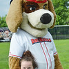 Madisyn Packard, 7, gives a big hug to Wachusett Dirt Dawg's mascot Digger during Starburst at Doyle Field in Leominster on Saturday evening. SENTINEL & ENTERPRISE / Ashley Green