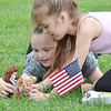 Madisyn Packard, 7, and Nicole Sidney, 7, play in the grass during Starburst at Doyle Field in Leominster on Saturday evening. SENTINEL & ENTERPRISE / Ashley Green
