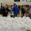 Vince Luppino and Sandy Woodall arrange the packed meals for delivery to people who could not attend the Effingham County FISH Community Thanksgiving Day Dinner. Jeff Long photo