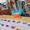 Jillian Primrose, 8, sells her handmade hair bows at the 24th Annual Ashby Pumpkin Fest on Saturday afternoon. SENTINEL & ENTERPRISE / Ashley Green