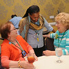 Ninth Triennial Gathering | Val Starr, director of discipleship for Women of the ELCA, chats with Elaine Scheer of Hawley, Minn., and Carol Fossum of Puyallup, Wash. Both women's synods sponsored an international guest.