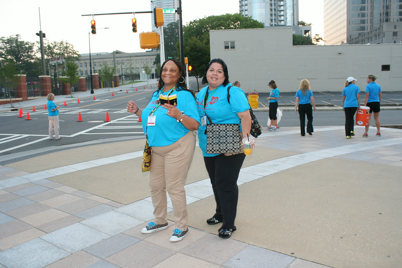 Ninth Triennial Gathering | Women of the ELCA staff, Eva Yeo (left) and Gabriela Contreras cheer on the paritcipants at the Run, Walk and Roll.