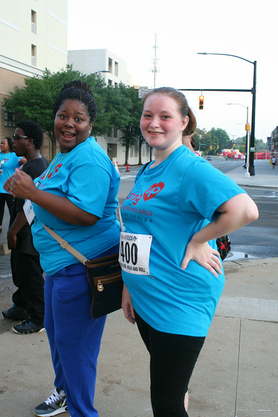 Ninth Triennial Gathering | Lidia Brown (left) Chicago, IL and Judy Jackson, Oak Park, IL, support participants in the Run, Walk and Roll