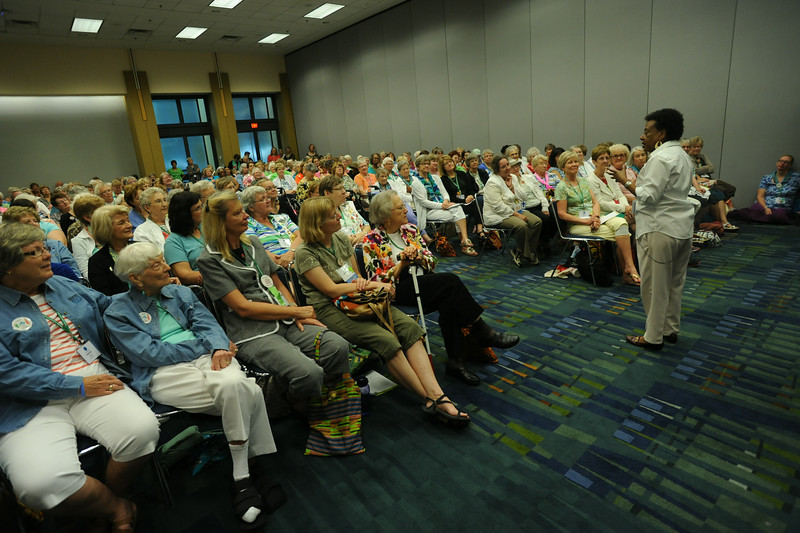 "Participants listen to My Haley tell the story of ""shared breath"" with her grandmother. Haley led the workshop, Generations: the quilt of our lives, which helped women connect their past to their future by telling stories that are the patchwork quilts of their lives."