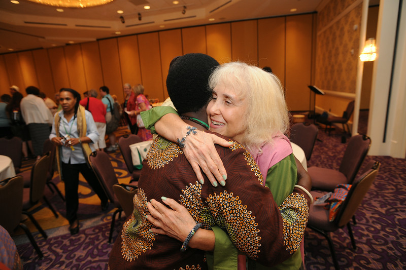 Ninth Triennial Gathering | Patricia Msseemmaa [this is correct] of LaSalle, Ill., hugs Mary Laiser from the Evangelical Lutheran church in Tanzania. Patricia's husband was from Tanzania.