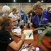 Karen O'Brien of St. Paul's Lutheran Church, Glenside, Penn., talks with Becca Stevens as she gets her book signed. JV